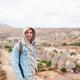 Tourist man outdoor on edge of cliff seashore - PhotoDune Item for Sale
