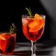 Negroni cocktail with smoking rosemary and orange garnish on black background - PhotoDune Item for Sale