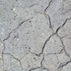 Gray dry cracked surface of volcanic soil turned into desert. Natural background or texture - PhotoDune Item for Sale