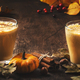 Pumpkin butter latte or coffee, keto drink on wooden table with fallen leaves - PhotoDune Item for Sale