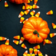 Halloween pumpkin and candy corn banner on blue baclground. Top view with copy space - PhotoDune Item for Sale