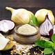 Onion powder in bowl on dark board - PhotoDune Item for Sale