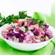 Salad with herring and beetroot in bowl on wooden board - PhotoDune Item for Sale