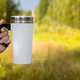 Mockup of a woman handing a travel mug - PhotoDune Item for Sale