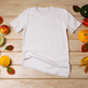 Unisex white T-shirt mockup with fall decor - PhotoDune Item for Sale