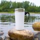 White travel mug mockup with stony river bottom - PhotoDune Item for Sale