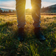 Hiking in the grassland, close up of male feet in leather boots walking through grassy landscape - PhotoDune Item for Sale