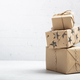 Stack of handcraft gift boxes on white brick background - PhotoDune Item for Sale