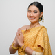 Beautiful Asian woman in traditional Thai dress costume white background - PhotoDune Item for Sale