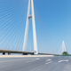 empty asphalt road and cable-stayed bridge background - PhotoDune Item for Sale