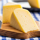 Block of hard cheese. Sliced cheese. - PhotoDune Item for Sale