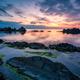 Sea sunrise at rocky beach - PhotoDune Item for Sale