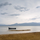 lonely boat on lake Prespa North Macedonia - PhotoDune Item for Sale
