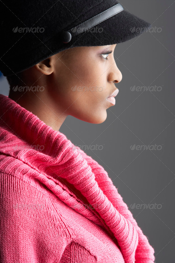 Fashionable Young Woman Wearing Cap And Knitwear In Studio - Stock Photo - Images