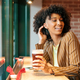Black woman with beer in pub - PhotoDune Item for Sale