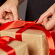 Banner Hands of cropped unrecognisable woman packing Christmas present - PhotoDune Item for Sale