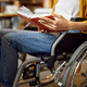 Disabled student in wheelchair reading a book - PhotoDune Item for Sale