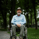 Adult disabled man in wheelchair holds paper sheet - PhotoDune Item for Sale