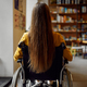 Disabled female student in wheelchair, back view - PhotoDune Item for Sale