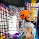 Little girl climbs on the ropes, zip line - PhotoDune Item for Sale