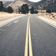 Empty mountain asphalt road on a cloudy day. - PhotoDune Item for Sale