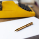 Pen on stack of paper and vintage old typewriter at wood desk table. Writer or study creative - PhotoDune Item for Sale