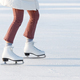 Closeup of woman legs in red checked trousers on skates on an open skating rink. Winter hobbies - PhotoDune Item for Sale