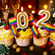 Cupcakes with new year candles wineglasses and smal gay flags decorations - PhotoDune Item for Sale