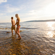 Young Couple Holding Hands Wading In Sea - PhotoDune Item for Sale