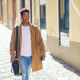 Young black man walking down the street carrying a briefcase and a smartphone - PhotoDune Item for Sale