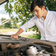Man opens the hood of a car to fix the car. - PhotoDune Item for Sale
