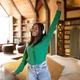 Beautiful African American lady with headphones dancing and singing, having fun at home - PhotoDune Item for Sale