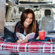 Senior woman having inside camper van reading a book and drinking coffee - Focus on face - PhotoDune Item for Sale