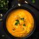 Pumpkin soup puree with cream and spices in black bowl - PhotoDune Item for Sale