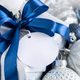 Christmas present with blue bow and round blank gift tag closeup, Mockup - PhotoDune Item for Sale