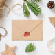 Christmas Composition with a card over sealed envelope flat lay - PhotoDune Item for Sale