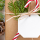 Christmas present with blank gift tag and candy cane top view, Mockup - PhotoDune Item for Sale