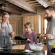 Family with small daughter cooking indoors, winter holiday in private apartment - PhotoDune Item for Sale