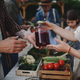 Close up of woman buying organic juice outdoors at local farmers market - PhotoDune Item for Sale