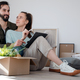 Young couple with tablet sitting on floor and planning when moving in new flat - PhotoDune Item for Sale