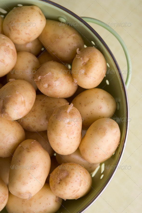 New Potatoes In Colander - Stock Photo - Images