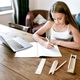 Blond girl having online class, homeschooling in the new normal - PhotoDune Item for Sale