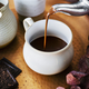 Pouring hot chocolate from a kettle food photography - PhotoDune Item for Sale