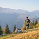 Athlete man runs through mountain meadowsautumn hills - PhotoDune Item for Sale