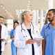 Mature doctor and mixed race nurse discussing patient case at hospital - PhotoDune Item for Sale