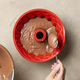 putting chocolate cake dough in silicone baking form - PhotoDune Item for Sale