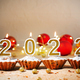 New year party number candles and cupcakes on christmas decorations background - PhotoDune Item for Sale