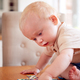 Baby Boy Having Fun Sitting At At Home And Playing With Jigsaw Puzzle Pieces - PhotoDune Item for Sale