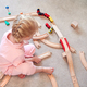 Overhead Shot Of Young Girl At Home Playing With Wooden Train Set Toy - PhotoDune Item for Sale