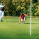 Woman playing golf, reading the green - PhotoDune Item for Sale
